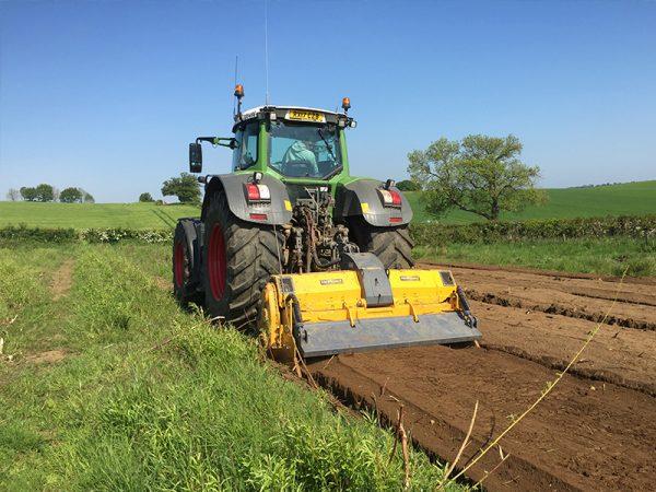 Mericrusher in field