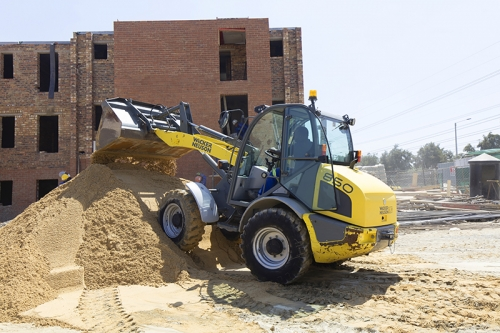 Wacker 850 Digger moving sand