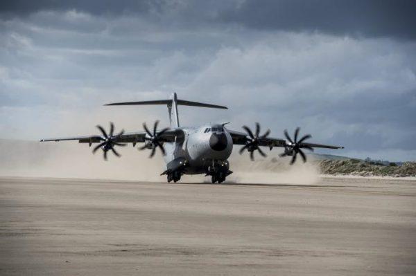 Plane landing on airstrip at Rock Barracks